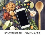 kitchen table with ingredients  ... | Shutterstock . vector #702401755