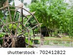 old wooden hydraulic turbine in ... | Shutterstock . vector #702412822