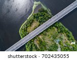 aerial view of the bridge and... | Shutterstock . vector #702435055