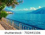 walkway along scenic como lake  ... | Shutterstock . vector #702441106