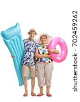 Small photo of Full length portrait of seniors with an air mattress and a swimming tire isolated on white background