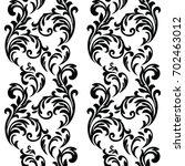 vintage baroque frame scroll... | Shutterstock .eps vector #702463012