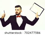 Small photo of Busy director in classic suit and red bow tie holding expensive pen and clip folder with copy space. Serious and overwrought, isolated on white background