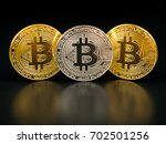 golden and silver bitcoin on... | Shutterstock . vector #702501256