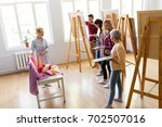painting  education and people... | Shutterstock . vector #702507016