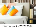 pillow on bed decoration... | Shutterstock . vector #702523906