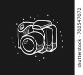 camera icon in doodle sketch... | Shutterstock .eps vector #702547072