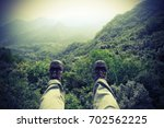 hiker legs on the top of...   Shutterstock . vector #702562225