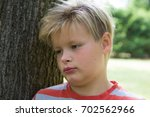 the boy in the park.  | Shutterstock . vector #702562966