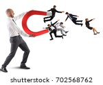 businessman attracts people... | Shutterstock . vector #702568762