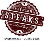 premium steaks vintage sign   Shutterstock .eps vector #702581536