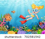 little girl diving in the sea | Shutterstock . vector #702581542