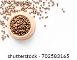 Stock photo large bowl of pet dog food spilling on white background top view mockup 702583165