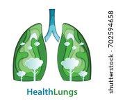 human lungs paper cut of... | Shutterstock .eps vector #702594658