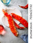 Small photo of Cooked crab phalanx with aioli sauce and lemon slices on metallic background. Top view with copy space.