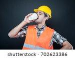 constructor wearing equipment...   Shutterstock . vector #702623386
