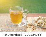 glass of chrysanthemum juice... | Shutterstock . vector #702634765
