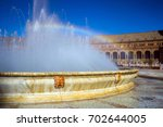 fountain and rainbow on square...   Shutterstock . vector #702644005
