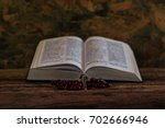 bible and a crucifix on an old... | Shutterstock . vector #702666946