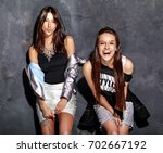 fashion portrait of two smiling ... | Shutterstock . vector #702667192