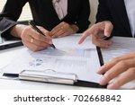 business team meeting... | Shutterstock . vector #702668842