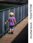 child walking alone by the... | Shutterstock . vector #702670708