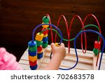Stock photo preschooler child playing with colorful toy kid playing with educational wooden toys at 702683578