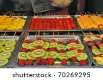 Strawberry and Kiwi sticks at a street food market in Beijing, China - stock photo