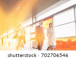 businesspeople walking while... | Shutterstock . vector #702706546