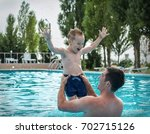 father and son funny in  water... | Shutterstock . vector #702715126