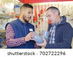 plumbers merchant with worker | Shutterstock . vector #702722296