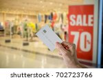 woman holds credit card for... | Shutterstock . vector #702723766