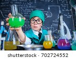smart boy scientist making... | Shutterstock . vector #702724552
