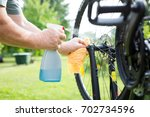senior man hands cleaning the... | Shutterstock . vector #702734596