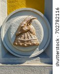 Small photo of Relief of the emblem from the helmet of albanian hero Skanderbeg. Tirana, Albania