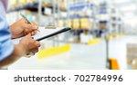 logistics service man writing...   Shutterstock . vector #702784996