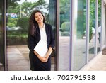 indian woman holding laptop and ... | Shutterstock . vector #702791938