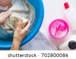 housewife washing clothes with... | Shutterstock . vector #702800086