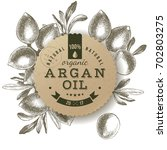 argan oil label with type... | Shutterstock .eps vector #702803275