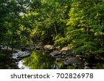 calm waters at glade creek in... | Shutterstock . vector #702826978