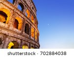 night colosseum photo with... | Shutterstock . vector #702884038