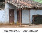 rural village poor house | Shutterstock . vector #702888232