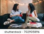 two women friends talking to... | Shutterstock . vector #702905896