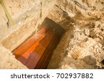 funeral  the coffin is lowered... | Shutterstock . vector #702937882
