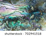 Small photo of Nature texture pattern of nacre mother-of-pearl inner side of Paua, Perlemoen or Abalone shell macro abstract background