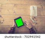 overhead shot of a man sitting... | Shutterstock . vector #702941542