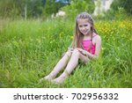 young girl resting in the park... | Shutterstock . vector #702956332