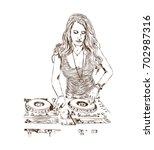 sketch of dj girl in vector...   Shutterstock .eps vector #702987316