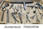 old tools on rustic background | Shutterstock . vector #703010938