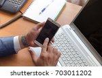 businessman holding a... | Shutterstock . vector #703011202
